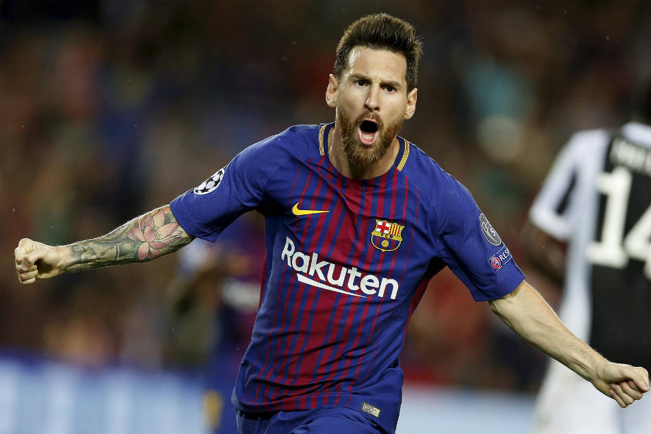 Barcelona's Lionel Messi celebrates scoring his side's first goal during a Champions League group D soccer match between FC Barcelona and Juventus at the Camp Nou stadium in Barcelona.