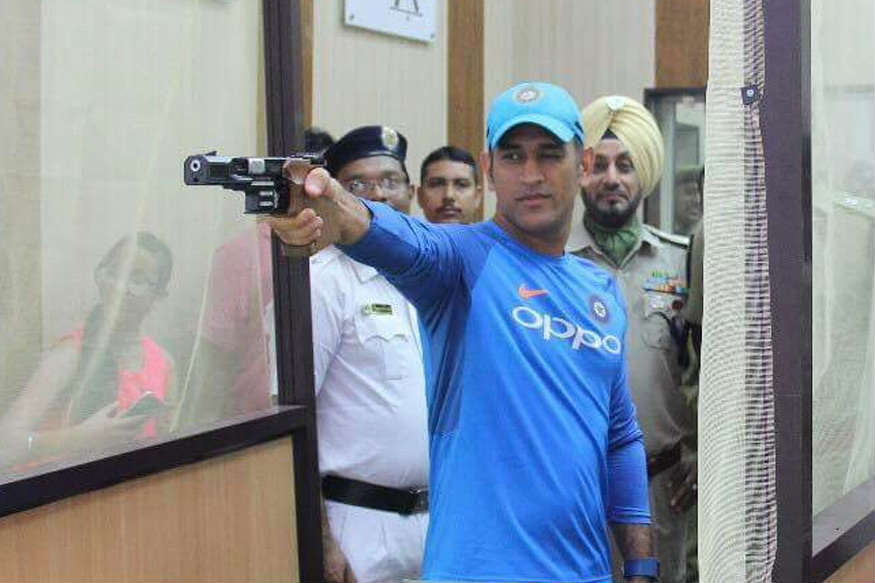 After Rain Dhoni Tries His Hand In Shooting