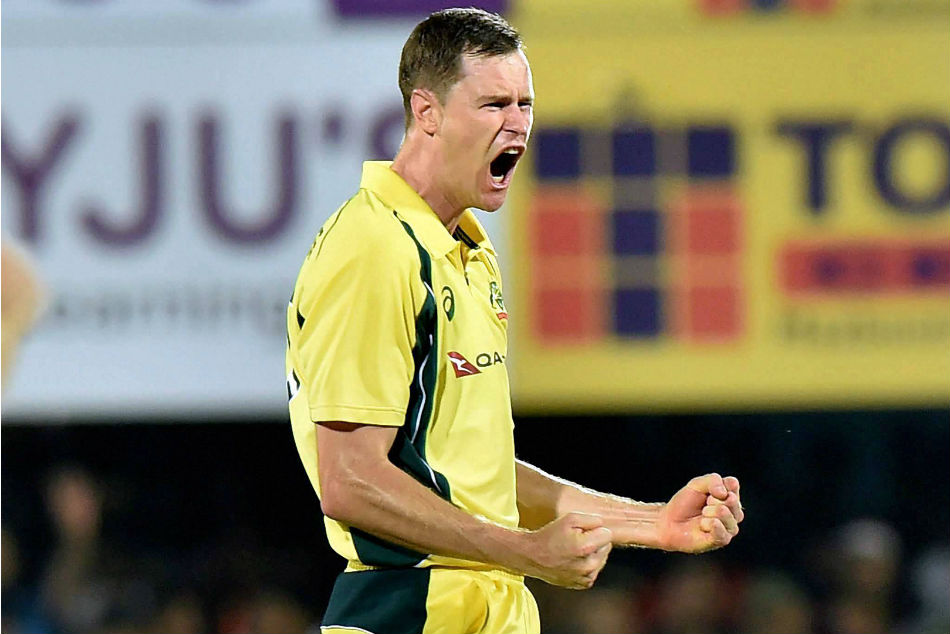 Australian bowlerJP Behrendorff exults after taking a wicket during the second T20 cricket match against India in Guwahati