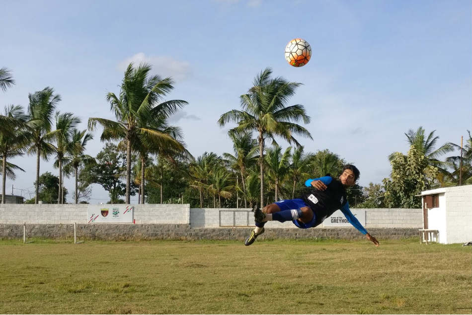 Avishek Singh of Rebels FC Football Academy attempts an overhead kick at their training ground in Kommaghatta, off Kengeri, in Bengaluru