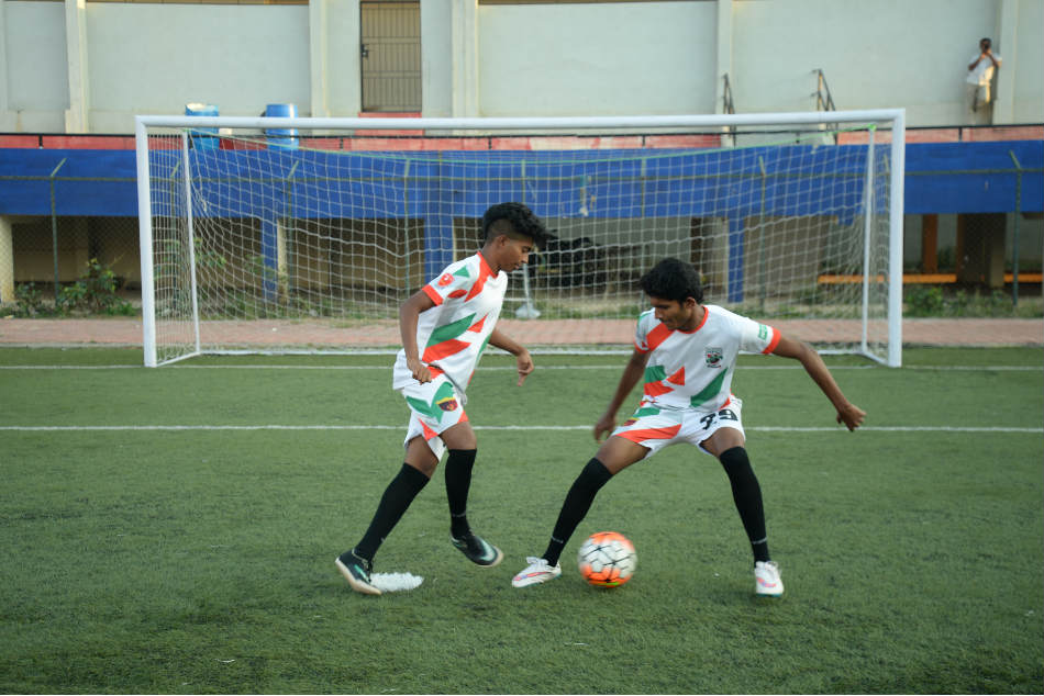 Rebels FC players warm up prior to a game at the Bangalore Football Stadium