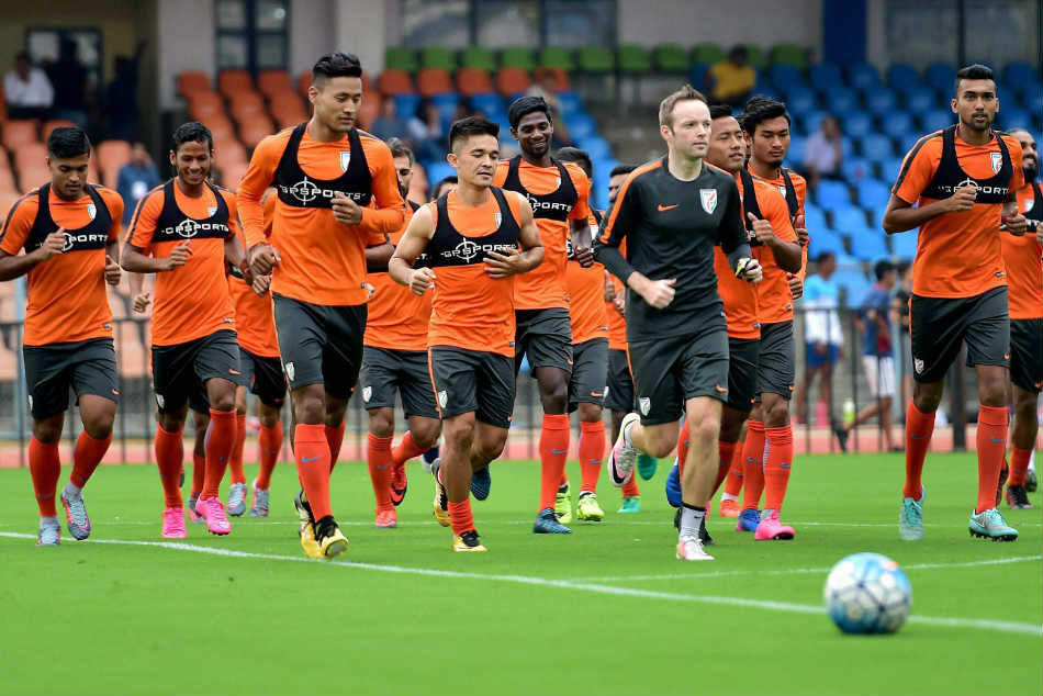 The Indian players warm-up during a training session.