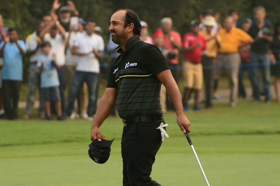 Shiv Kapur celebrates his eagle on the 18th hole.