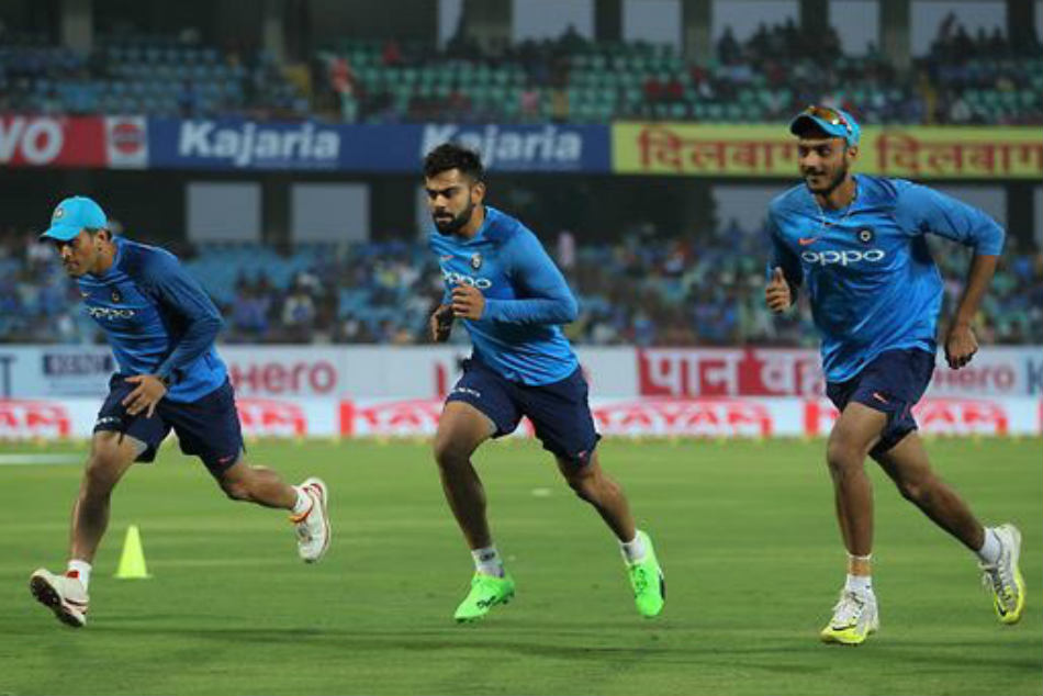 Axar Patel reveals its hard to beat legends MS Dhoni and Virat Kohli in race
