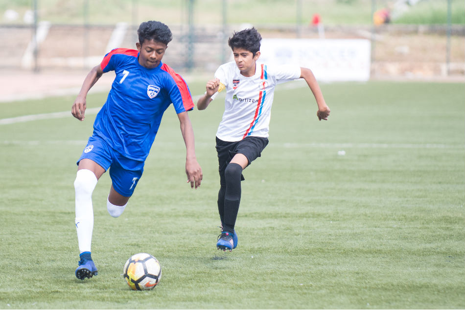 Bengaluru FC's U-13 striker Ankith P (left) in action against Stadium Sports Foundation at the Bangalore Football Stadium on Saturday