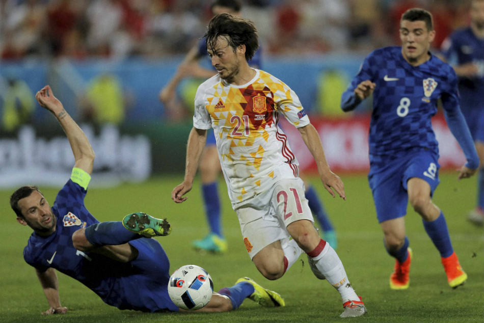 Spain's David Silva (centre) tackled by Croatia's Darijo Srna