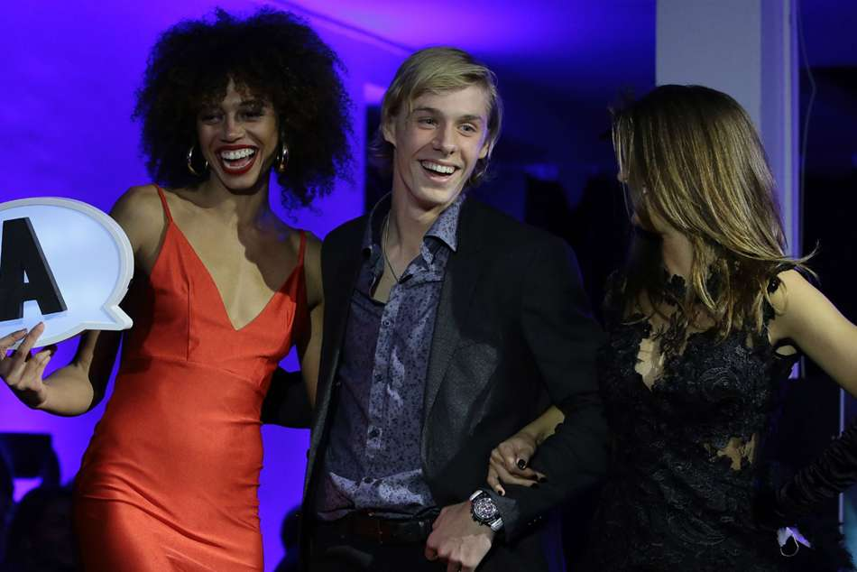 Denis Shapovalov (centre) with female models during the draw ceremony of the Next Gen ATP Finals