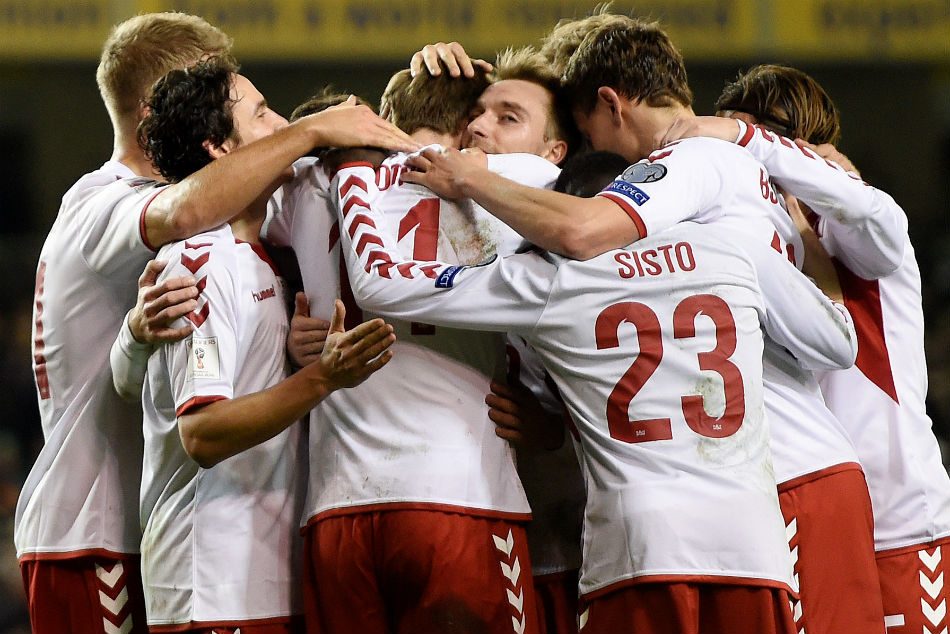 Christian Eriksen celebrates with team-mates