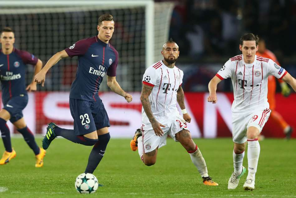PSG's Julian Draxler (left) in Champions league action against Bayern Munich
