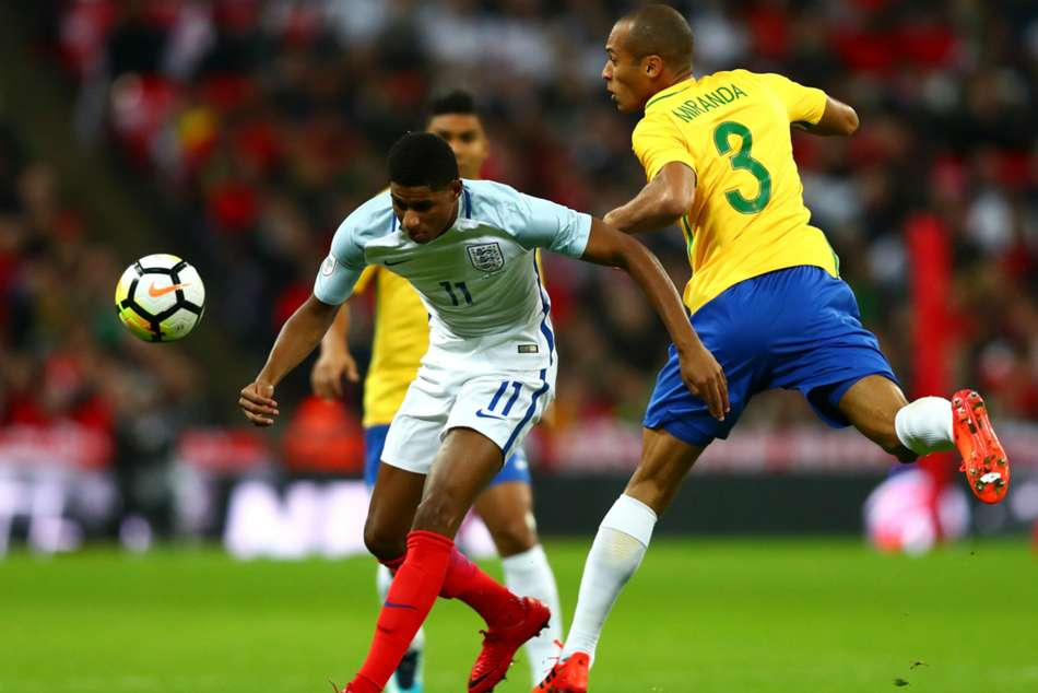 England and Brazil in action
