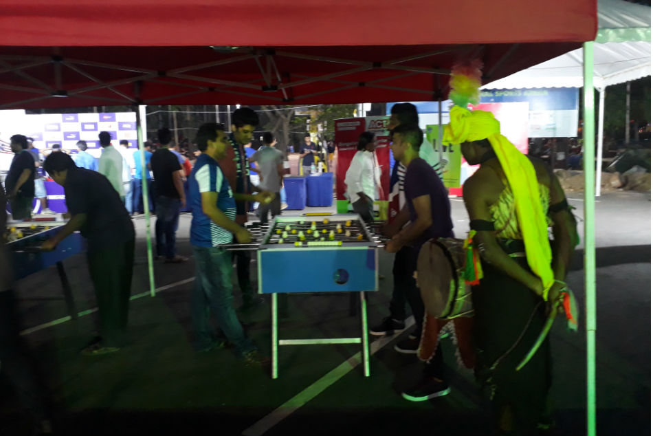 Fans indulge in Foosball at the BFC fan zone