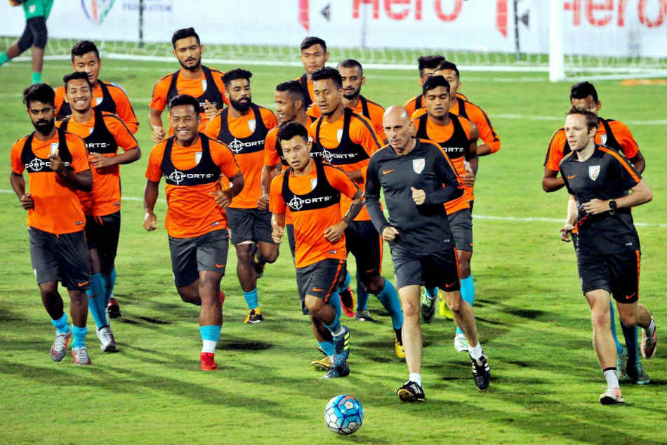 The Indian football team warm-up during a practice session.