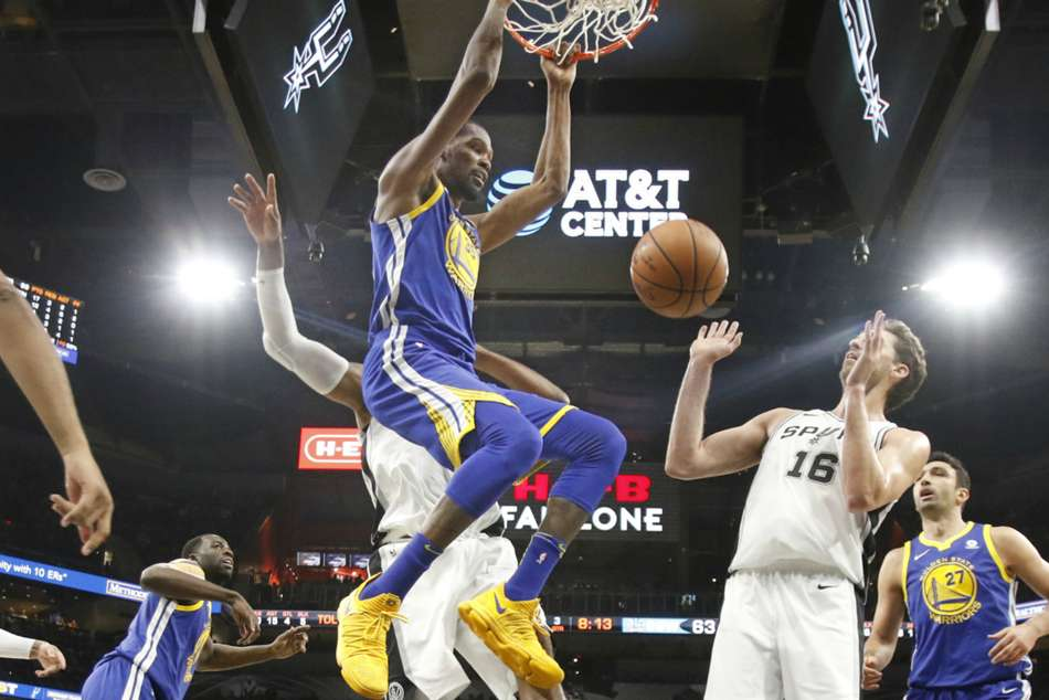 Golden State Warriors' Kevin Durant blocks during win against San Antonio Spurs