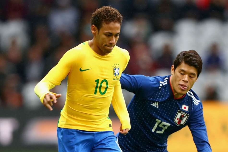Neymar (left) in Brazil colours