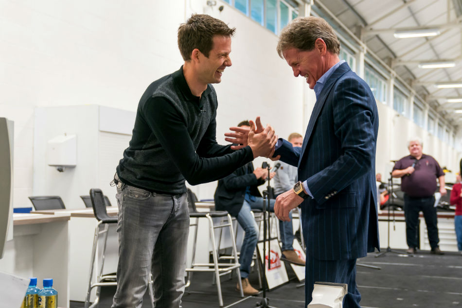 Sebastien Ogier shakes hands with M Sport team principal Malcolm Wilson