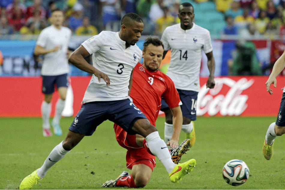 France's Patrice Evra (left) tackled by Switzerland's Haris Seferovic