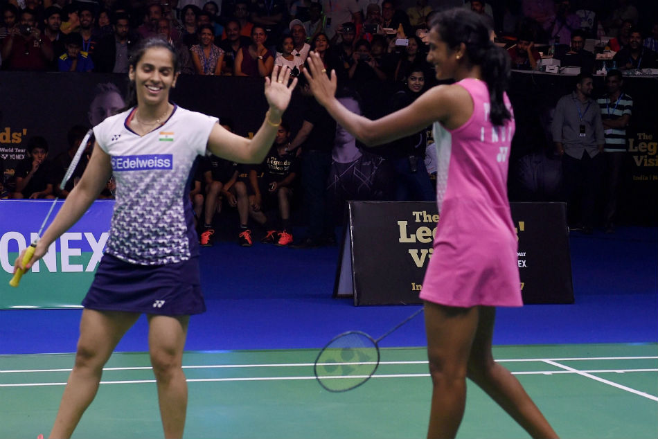 Saina Nehwal, left, will take on PV Sindhu in he final of national badminton championship.