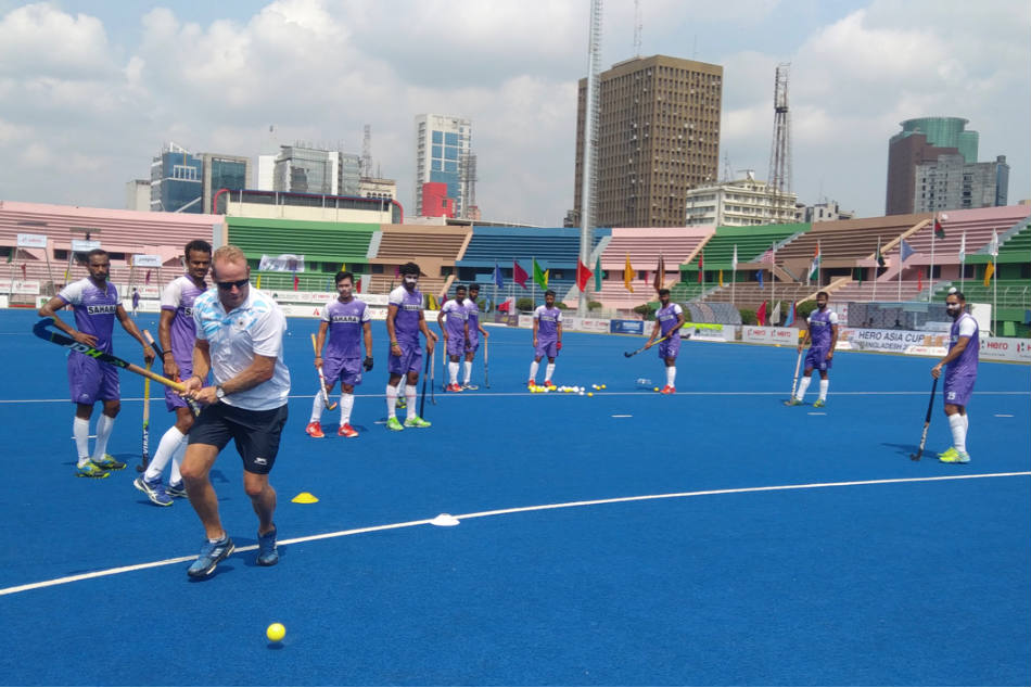 Indian hockey team coach Sjoerd Marijne and his players during a training session