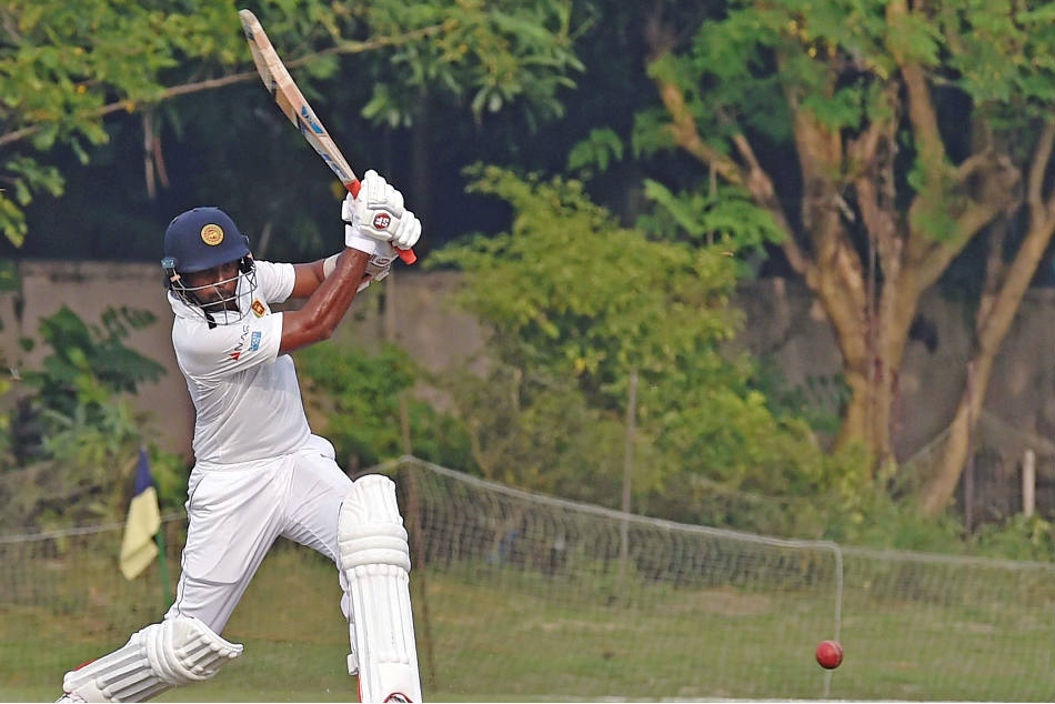 Sri Lanka's Dilruwan Perera in action against Board President XI during a warm-up match at Jadavpur University Stadium