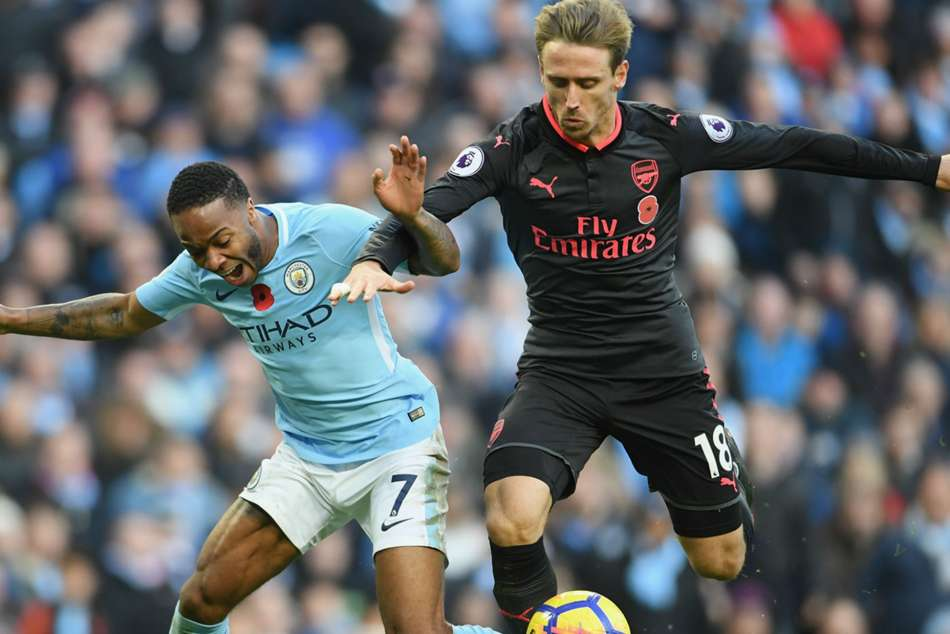 Raheem Sterling, left, and Nacho Monreal