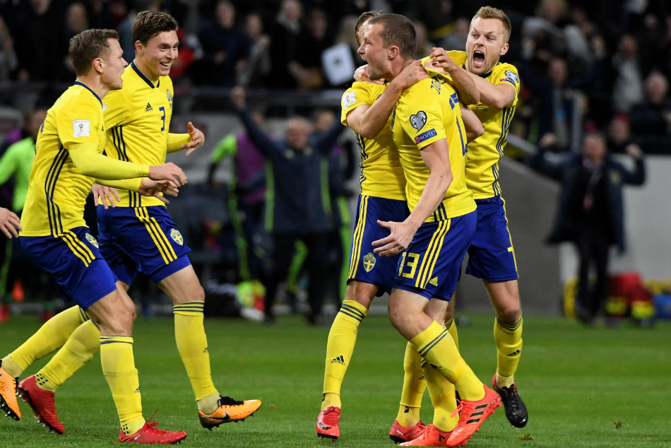 Jakob Johansson celebrates with team-mates after scoring
