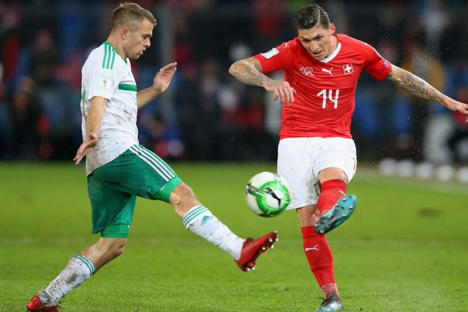 Northern Ireland's Ward (left) attempts to block Switzerland's Steven Zuber