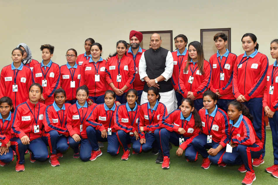 The women's football team from Jammu and Kashmir with Union Home Minister Rajnath Singh.