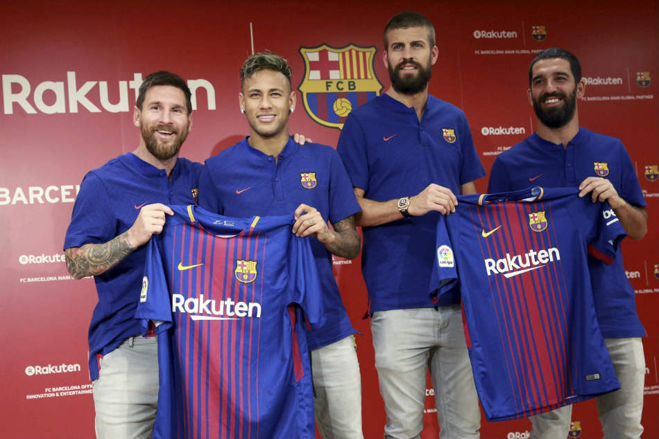 File photo: From left, FC Barcelona's Lionel Messi, Neymar, Gerard Pique and Arda Turan pose with their new jerseys.
