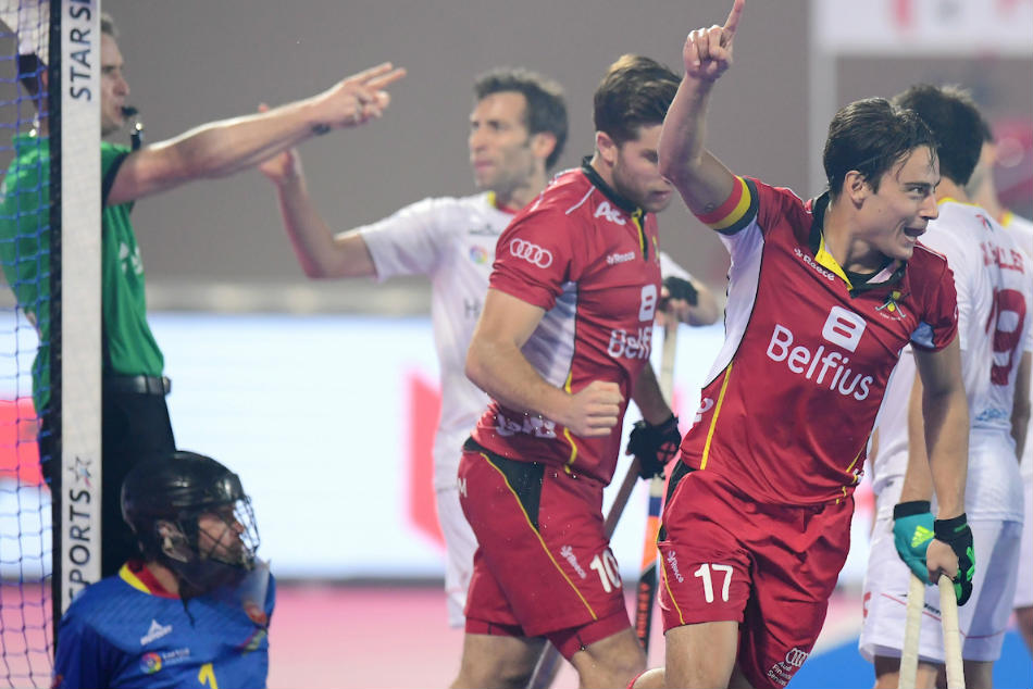 Belgium's Thomas Briels (right) wheels away after a goal by Cedric Charlier (No 10) against Spain during the HWL Final match against Spain in Bhubaneswar on Sunday (image courtesy: FIH)