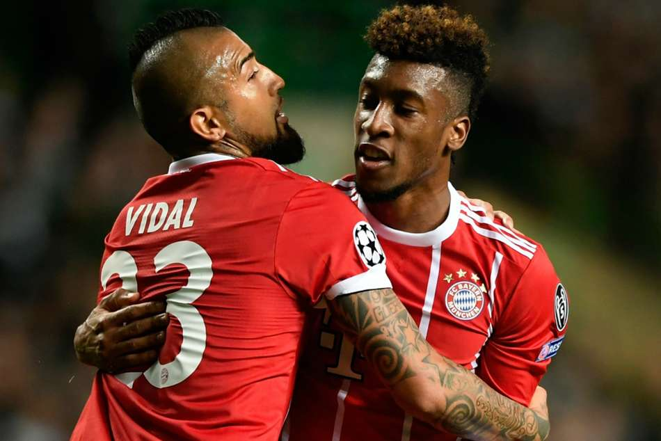 Kingsley Coman (right) of Bayern Munich with teammate Arturo Vidal
