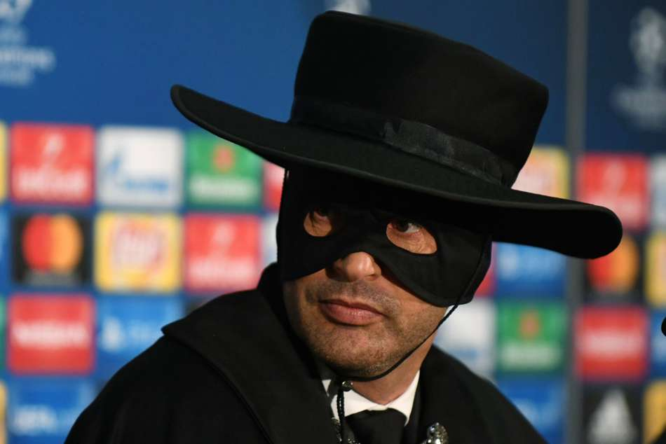 Shaktar coach Paulo Fonseca dressed up as Zorro attends media conference