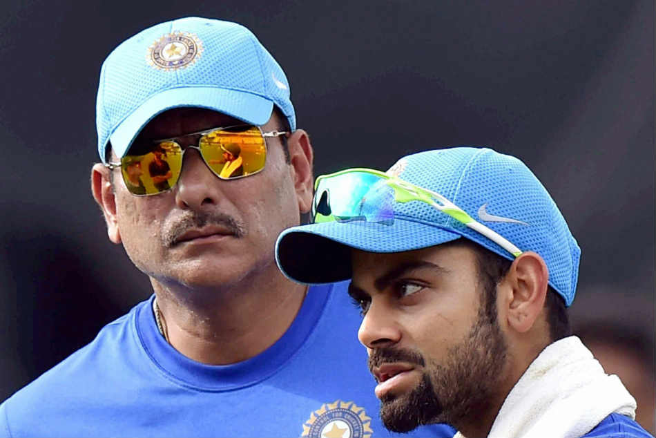 Virat Kohli (right) with India cricket coach Ravi Shastri