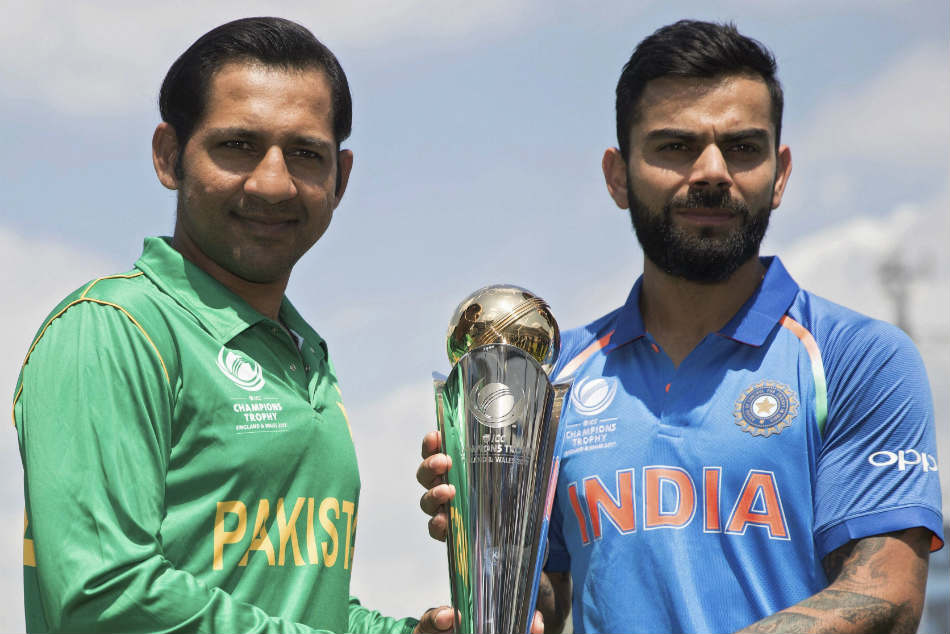 File photo: India captain Virat Kohli, right, and Pakistan's captain Sarfraz Ahmed pose for a picture with the trophy at the Oval cricket ground in London.