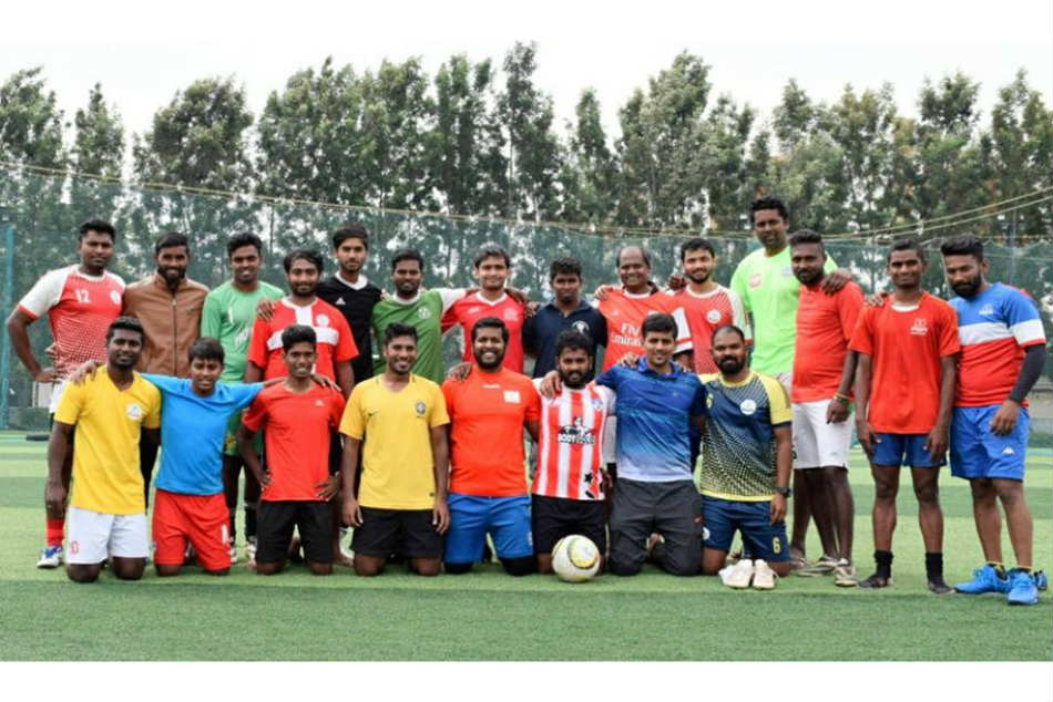 Shivaprasad S (standing fourth from left) of Income Tax with his teammates of the BDFA A Division team