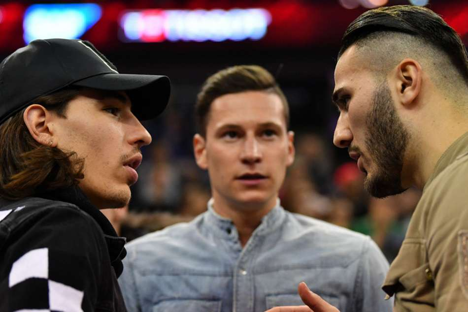 PSG's Julian Draxler (centre) pictured with Arsenal's Sead Kolasinac and Hector Bellerin