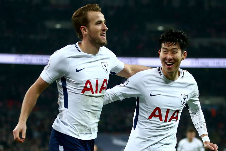 Tottenham's Harry Kane (left) and Heung-min Son celebrate after scoring a goal