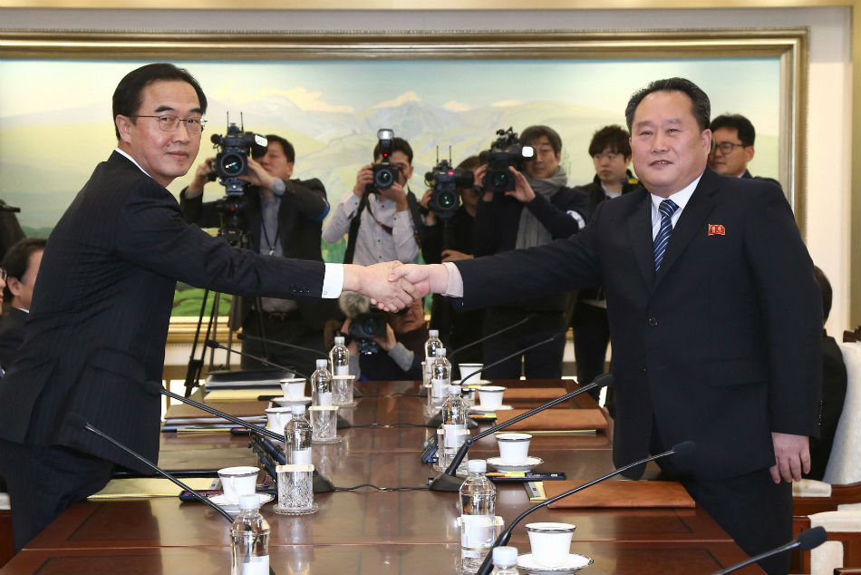 South Korean Unification Minister Cho Myoung-Gyon, left, shakes hands with North Korean delegation head Ri Son Gwon after the meeting.