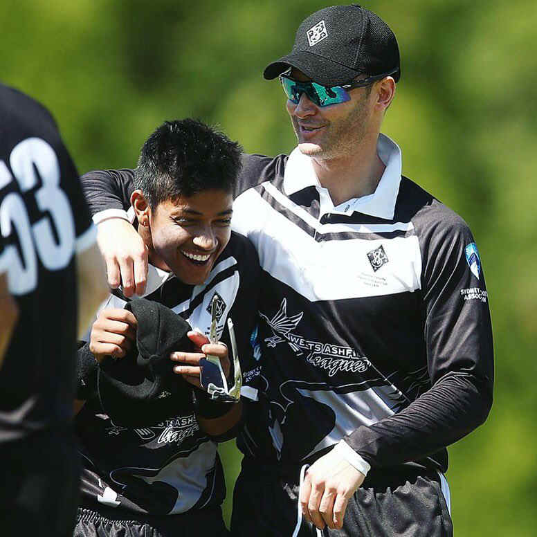 Sandeep Lamichhane with Michael Clarke