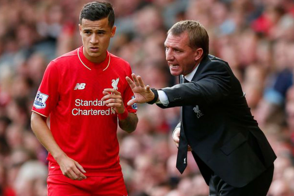 Philippe Coutinho (left) given instructions by then Liverpool boss Brendan Rodgers