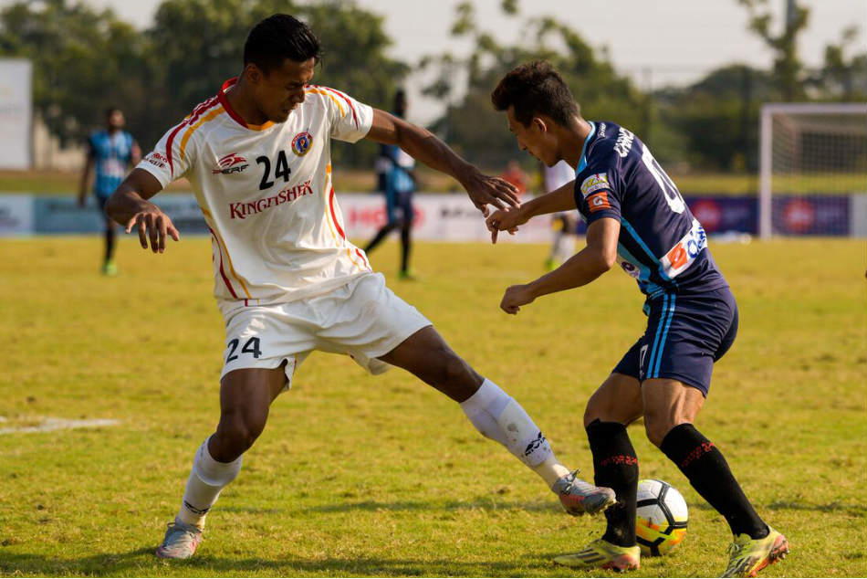 Minerva Punjab's Chencho Gyeltshen (right) is tackled by East Bengal's Salam Ranjan Singh during their I-League match (Image: AIFF Media)