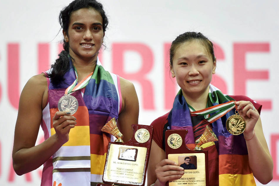 PV Sindhu (left) poses with her silver after losing to Beiwen Zhang in the India Open Super 500 badminton tournament