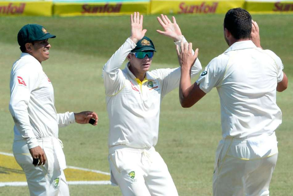 Australia captain Steve Smith celebrates a dismissal with Mitchell Starc during the first Test against South Africa in Durban