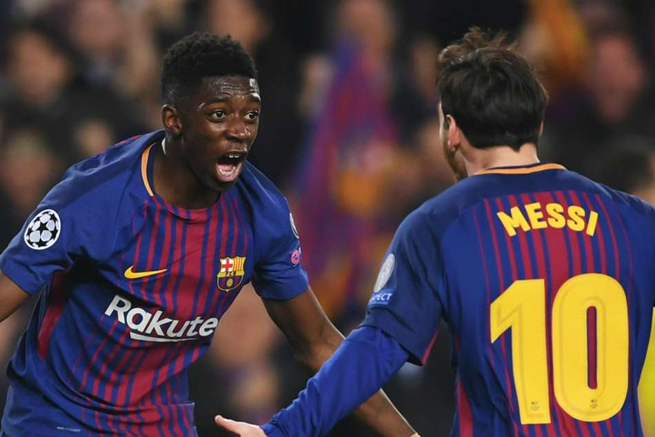 Ousmane Dembele of Barcelona (left) celebrates with Lionel Messi after a goal against Chelsea during their Champions League Round-of-16 match at Camp Nou