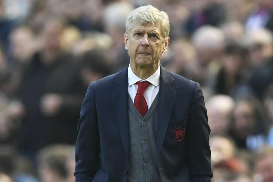Arsene Wenger says he never regretted staying back at Arsenal