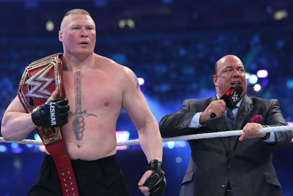 Brock Lesnar (left) with manager Paul Heyman (Image Courtesy: WWE.com)