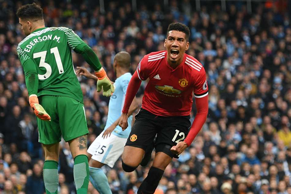Chris Smalling celebrates after scoring Manchester Uniteds winner