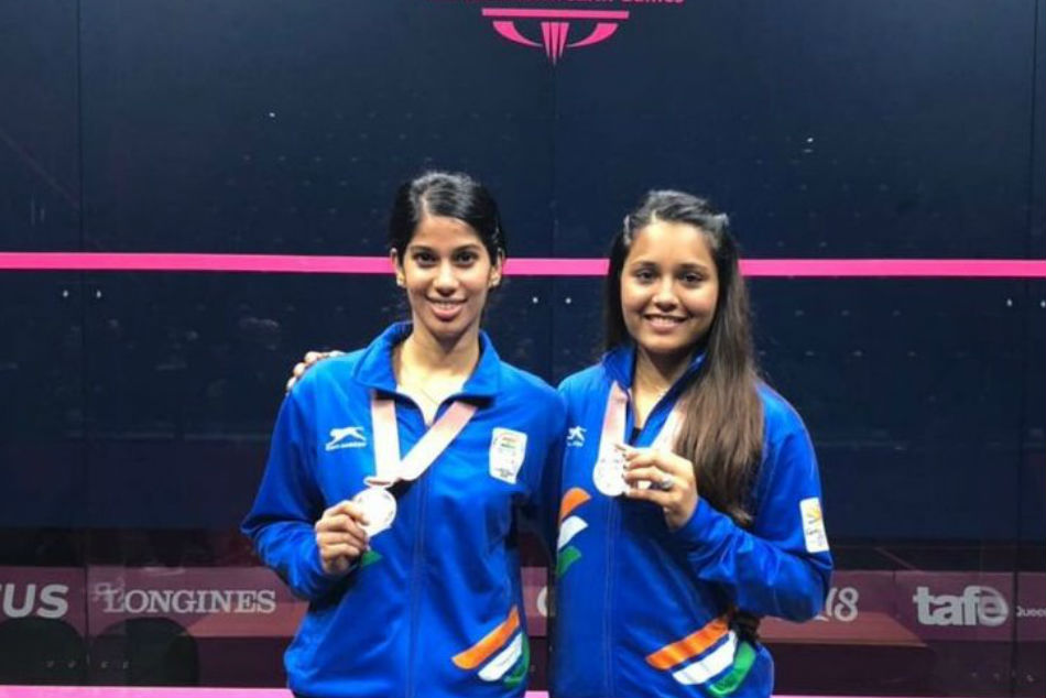 Indias leading squash players Joshna Chinappa (left) and Dipika Pallikal pose with their medals
