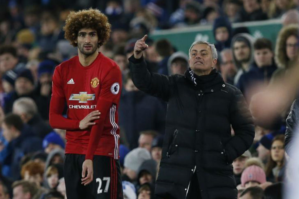 Maroune Fellaini of Manchester United (left) with manager Jose Mourinho
