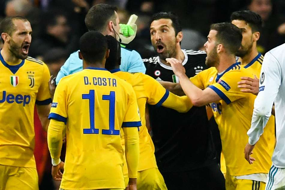 Juventus goalkeeper Gianluigi Buffon (centre) seen arguing with referee Michael Oliver