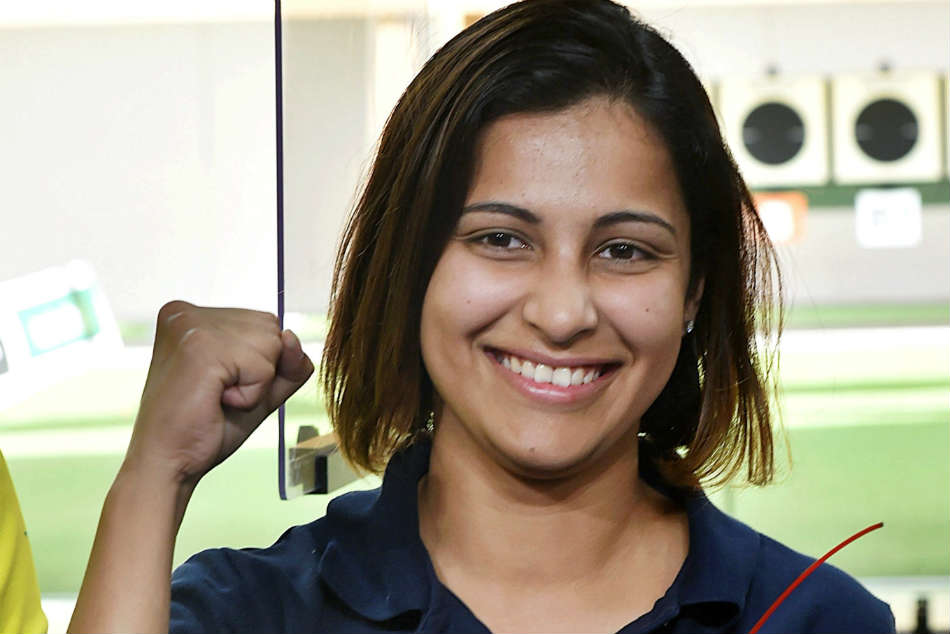 Indias Heena Sidhu celebrates after winning the gold in 25M Pistol event in the Commonwealth Games